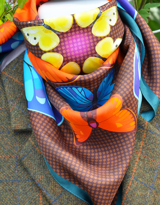 Butterfly Kaleidoscope Autumn scarf styled with jacket